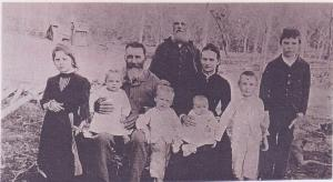 Jens and Mary Iverson with their children, one of the Mulcahy boys and Jens' friend Jacob Neilsen c1896